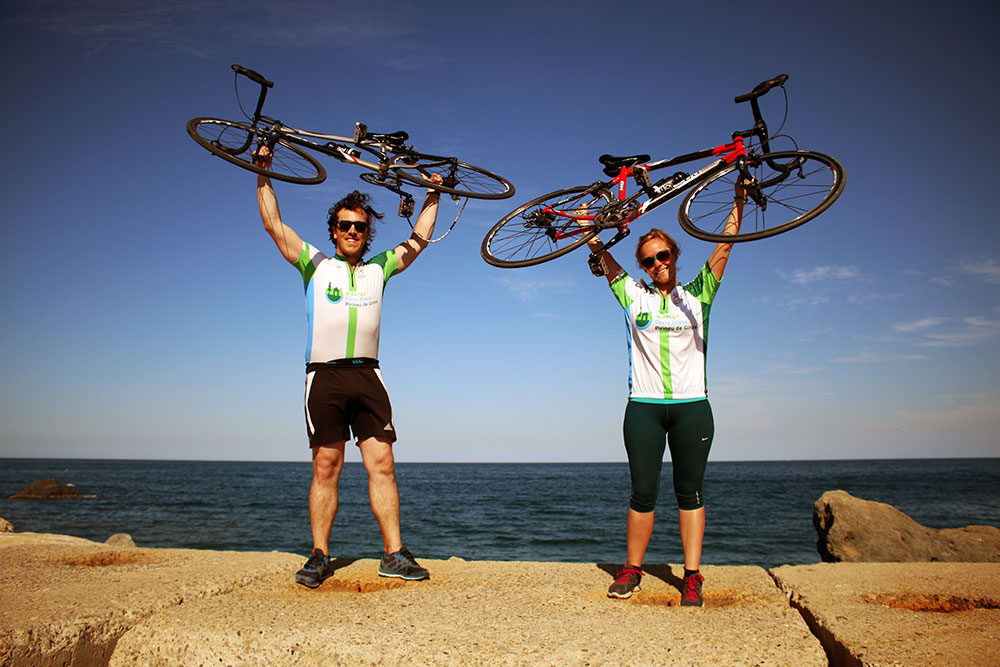 Celebrating after cycling from the Pyrenees to the Costa Brava in Catalonia.